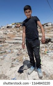 Hebron, Palestine, July 30, 2014: Palestinian  boy pose to the picture  on the streets of Hebron