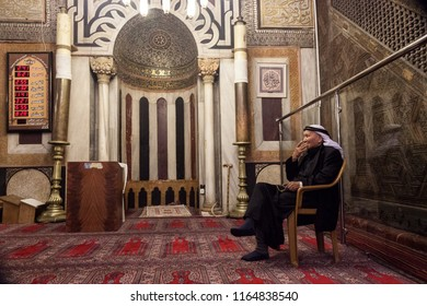 Hebron, Palestine, June 21, 2014: A Palestinian elderly man sits on a chair in the main hall in historic Abraham mosque in Hebron.