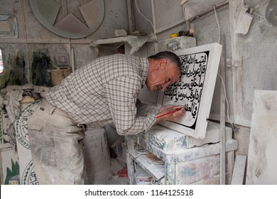 Hebron, Palestine, June 4, 2014: A Palestinian work in a marble workshop which produces stone Quoranic domestic decorations.