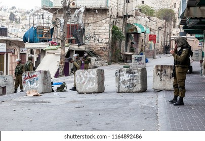 Hebron, Palestine, November 29, 2013:  Israel Defence Forces soldiers are standing by a road block in Hebron