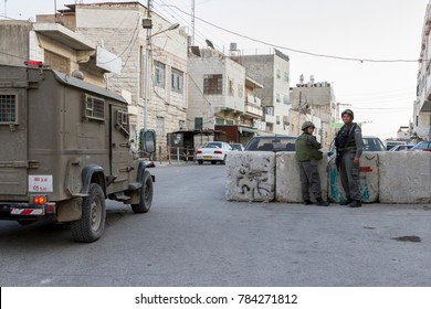 Hebron, Palestine, November 7 2010 Israeli soldiers patrol streets of old town of Hebron. Hebron old town has been closed by Israel Defence Forces to protect group of Jew who illegally occupy the area