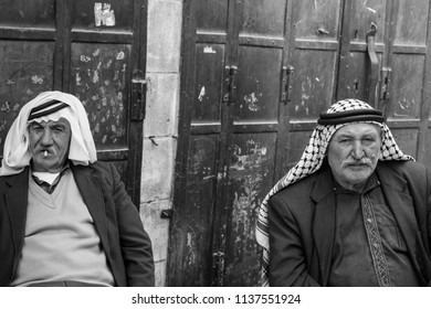 Hebron, West-Bank, Occupied Palestinian Territory, Israel, 22.09.2017,Two palestinian men are sitting having a chat an zigarettes in the old part of the town of hebron