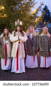 HEBY, SWEDEN - DECEMBER 13: Undentified people in Santa Lucia at Christmas celebration in Heby city on December 13, 2014 in Heby Sweden