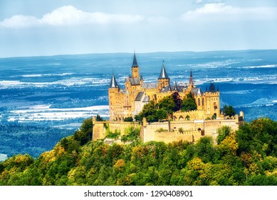 Hechingen, Germany - August  17, 2018: Aerial view of famous Hohenzollern Castle on a forested hill with autumnal colors. Hechingen, Baden-Wurttemberg, Germany.
