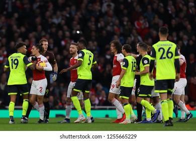 Hector Bellerin of Arsenal and Daniel Williams of Huddersfield Town clash - Arsenal v Huddersfield Town, Premier League, Emirates Stadium, London (Holloway) - 8th December 2018