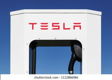 Hedensted, Denmark - May 5, 2018: Tesla supercharger station. Tesla is an American automotive and energy storage company that designs, manufactures, and sells luxury electric cars