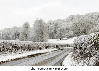 Hedge Lined Country Lane Surrounded by Snowy Fields in Winter, Penn, Buckinghamshire, England, UK