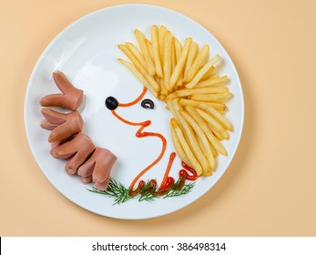 Hedgehog. French fries and sausages arranged as funny hedgehog decoration for children