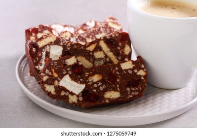 Hedgehog slice - chocolate dessert with biscuit, marshmallow and cherry