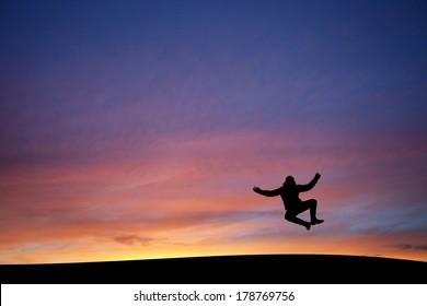 heel clicking man in sunset