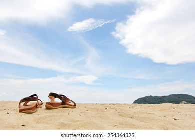 The heel strap Sandals on the sand and the sky