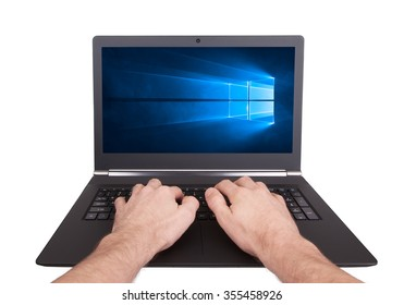 HEERENVEEN, NETHERLANDS, June 6, 2015: Laptop computer with Windows 10 background. Windows 10 is the new version of Windows OS by Microsoft Corporation; it starting July 29, 2015.