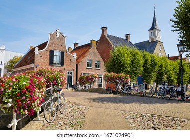 The 'Heerewal' (Gentleman's street) with the tower of the Reformed church in the picturesque fortress town of 'Sloten', the province of 'Friesland', north of the Netherlands