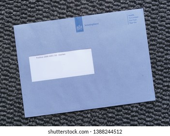 Heerlen, Netherlands. May 2019. Official blue envelope from the Dutch Tax and Customs Administration (Dutch: Belastingdienst).