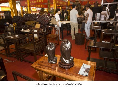 HEFEI CHINA-September 21, 2014:consumers visited the Eighth China (Hefei) international cultural exposition to visit and buy mahogany furniture.