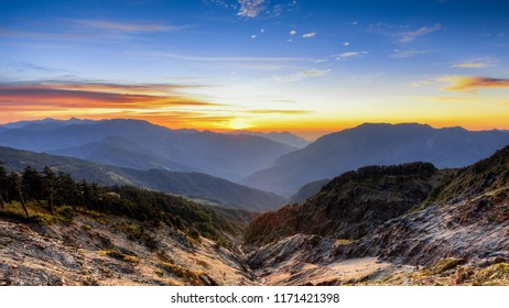 Hehuanshan, Taiwan, is a popular destination for the local people. One can enjoy magnificent sunrise, mountain ranges, alpine landscape, and steep valley. The sun provides warmth to the place.