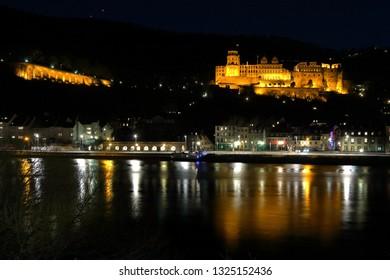 Heidelberg Castle and Neckarufer illuminated in the evening
