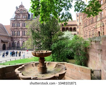 HEIDELBERG, GERMANY - APRIL 22, 2014: Courtyard of old Heidelberg castle with tourists.