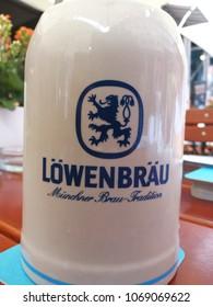 "Heidelberg, Germany - August 24, 2017: Löwenbräu Beer Stein. Löwenbräu is a brewery in Munich owned by Anheuser-Busch InBev. Its name means ""lion's brew"" in German"