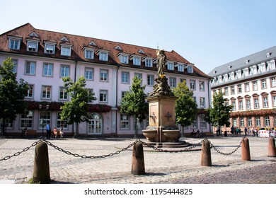 HEIDELBERG, GERMANY - AUGUST 25 : German and foreigner travelers people walking and visit madonna statue at the corn market square or madonna vom kornmarkt on August 25, 2017 in Heidelberg, Germany