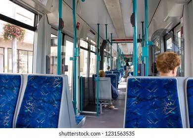 HEIDELBERG, GERMANY - AUGUST 25 : German passengers people sitting on tramway go to Heidelberger altstadt or old town at Sandhausen district village station on August 25, 2017 in Heidelberg, Germany