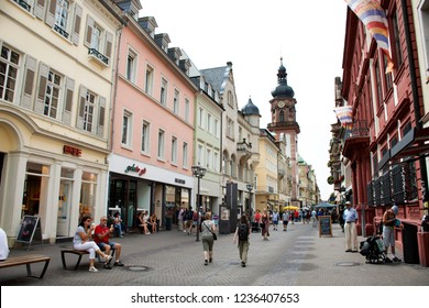 HEIDELBERG, GERMANY - AUGUST 25 : German people and foreign travelers walking visit and sit eat and drink at heidelberger old town market square or marktplatz on August 25, 2017 in Heidelberg, Germany