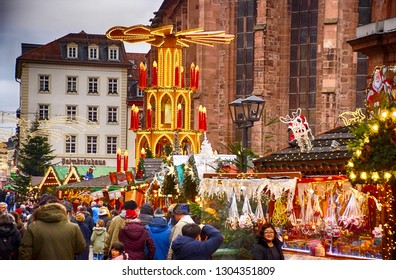HEIDELBERG, GERMANY - DEC 19, 2018 - Christmas market in the cathedral square of Heidelberg, Germany