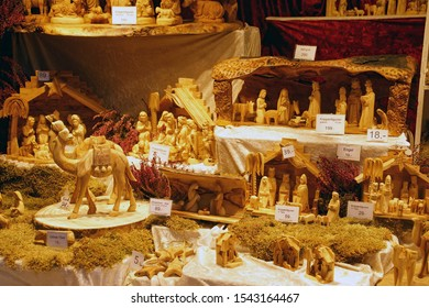 HEIDELBERG, GERMANY - DEC 19, 2018 - Hand carved wooden figures for nativity creche, Christmas market,Heidelberg, Germany