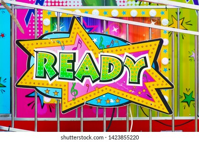 Heidelberg, Germany - May 2019: Colorful retro comic style sign saying 'Ready' on funfair attraction