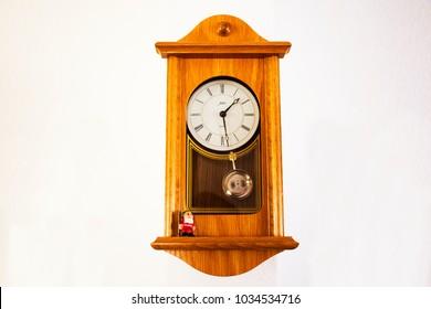 HEIDELBERG, GERMANY - SEPTEMBER 9 : Wooden Classic clock germany style on wall in house on September 9, 2017 in Heidelberg, Germany