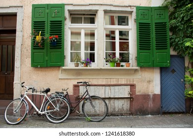 HEIDELBERG, GERMANY-AUGUST 25 : German people stopping and lock bicycle at front of classic and retro house at Heidelberger or Heidelberg old town on August 25, 2017 in Heidelberg, Germany