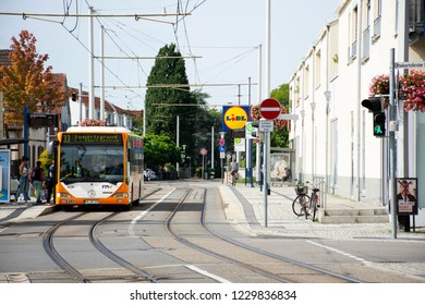 HEIDELBERG, GERMANY-AUGUST 25 : Tramway run and stopping for send and receive passengers German people and foreign travelers in station at Sandhausen village on August 25, 2017 in Heidelberg, Germany