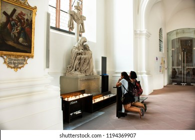 HEIDELBERG,GERMANY-AUGUST 25 : German people burn candle for remember and praying respect to Blessed Virgin Mary and Jesus Christ statue in Jesuitenkirche church August 25, 2017 in Heidelberg, Germany