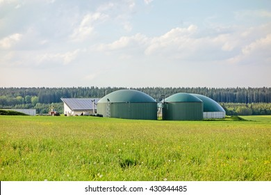 Heidenheim, Germany - May 26, 2016: Biogas plant, barn with photovoltaics, tractor aside, green meadow in front