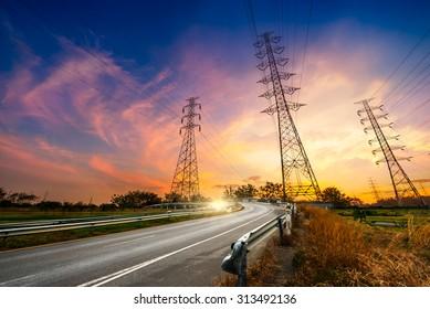 Height voltage electricity pylon system on sunrise background