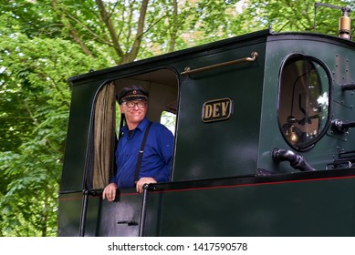 Heiligenberg, Germany - May 19, 2019: train driver in historic dress in cab of a vintage steam locomotive