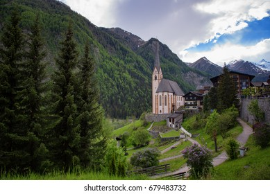 Heiligenblut with St Vincent Church in the background the beautiful Grossglockner. Beautiful sunny summer day in Austria.