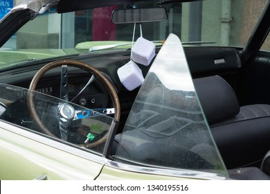 HEILIGENHAUS, NRW, GERMANY - SEPTEMBER 10, 2017:Fuzzy Dice on the rearview mirror of a vintage American car