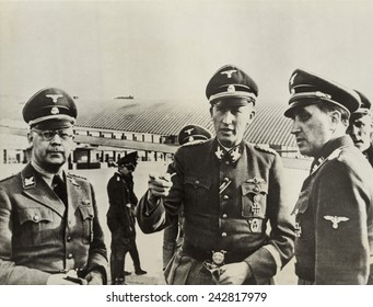 Heindrich Himmler (left)and Heydrich Reinhard (center), Hitler's architects of the Holocaust, in Paris, ca. 1940-42. Fritz Lang's 1943 film HANGMEN ALSO DIE is based on Heydrich's 1942 assassination.
