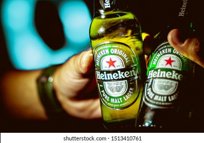 Heineken, Beer. Photograph of two men toasting with two bottles of heineken beer. Brasília, Federal District - Brazil. Circa, September, 2019.