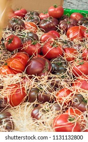 Heirloom and hothouse tomatoes in open air market stand
