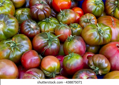 Heirloom tigerstripe tomatoes at a farmers market