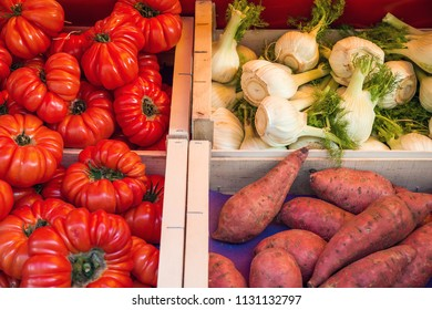 Heirloom tomatoes, fennel bulbs and sweet potatoes in French open air market