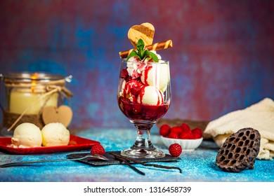 Heisse Liebe austrian dessert, vanilla ice cream with raspberry sauce - Shutterstock ID 1316458739