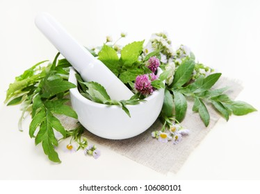 Helathy Spa Composition with Herbs and Mortar
