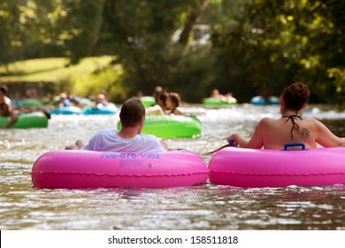 HELEN, GA - AUGUST 24:  A couple enjoys tubing down the Chattahoochee River with hundreds of others in North Georgia on a warm summer afternoon, on August 24, 2013 in Helen, GA.