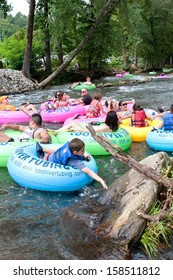 HELEN, GA - AUGUST 24:  Families enjoy tubing down the Chattahoochee River in North Georgia on a warm summer afternoon, on August 24, 2013 in Helen, GA.   Hundreds could be seen  tubing on the river.