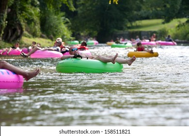 HELEN, GA - AUGUST 24:  People enjoy tubing down the Chattahoochee River in North Georgia on a warm summer afternoon, on August 24, 2013 in Helen, GA.  Hundreds of people went tubing down the river.