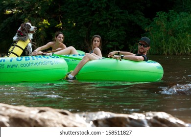 HELEN, GA - AUGUST 24:  People tube down the Chattahoochee River in North Georgia, with a dog wearing a life vest in its own tube, on August 24, 2013 in Helen, GA.  Hundreds went tubing on the river.
