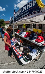 Helen, GA / USA - June 2, 2018:  A woman looks over the merchandise at the Trump Shop, a popup outdoor store selling Donald Trump apparel and other items in a parking lot on June 2, 2018 in Helen, GA.